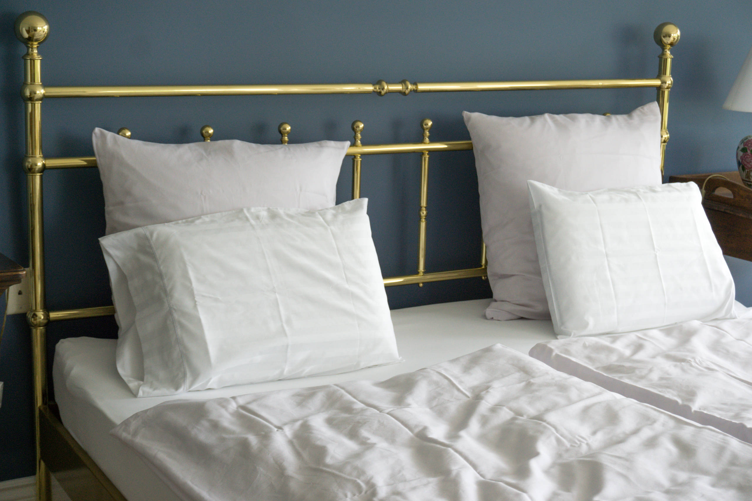 Brass headboard of the bed in The Bay View Suite at The Empty Nest in Prince Edward County