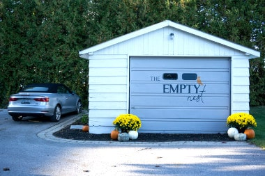 Garage with logo of The Empty Nest