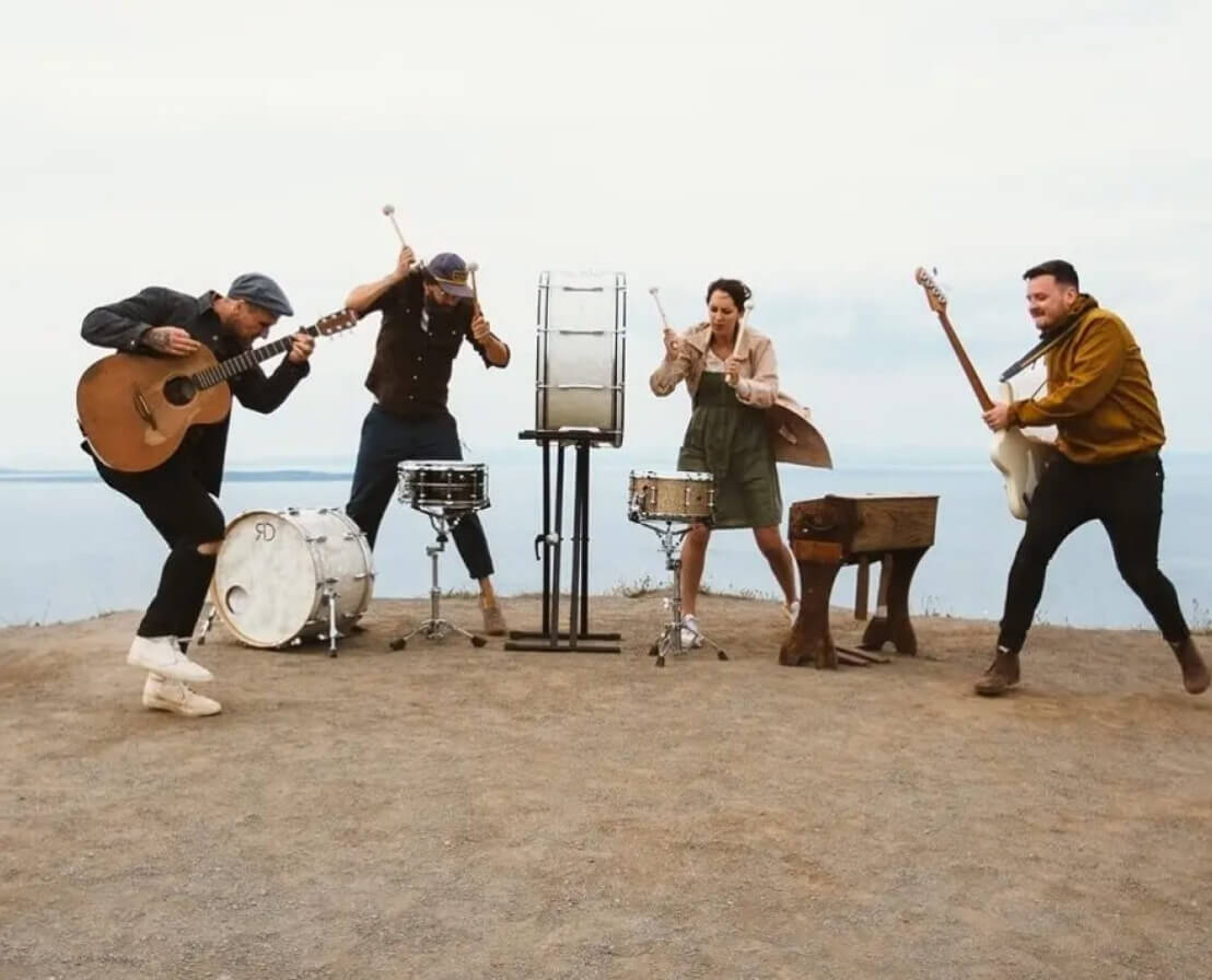 Image of the band Rend Collective playing music on a cliff