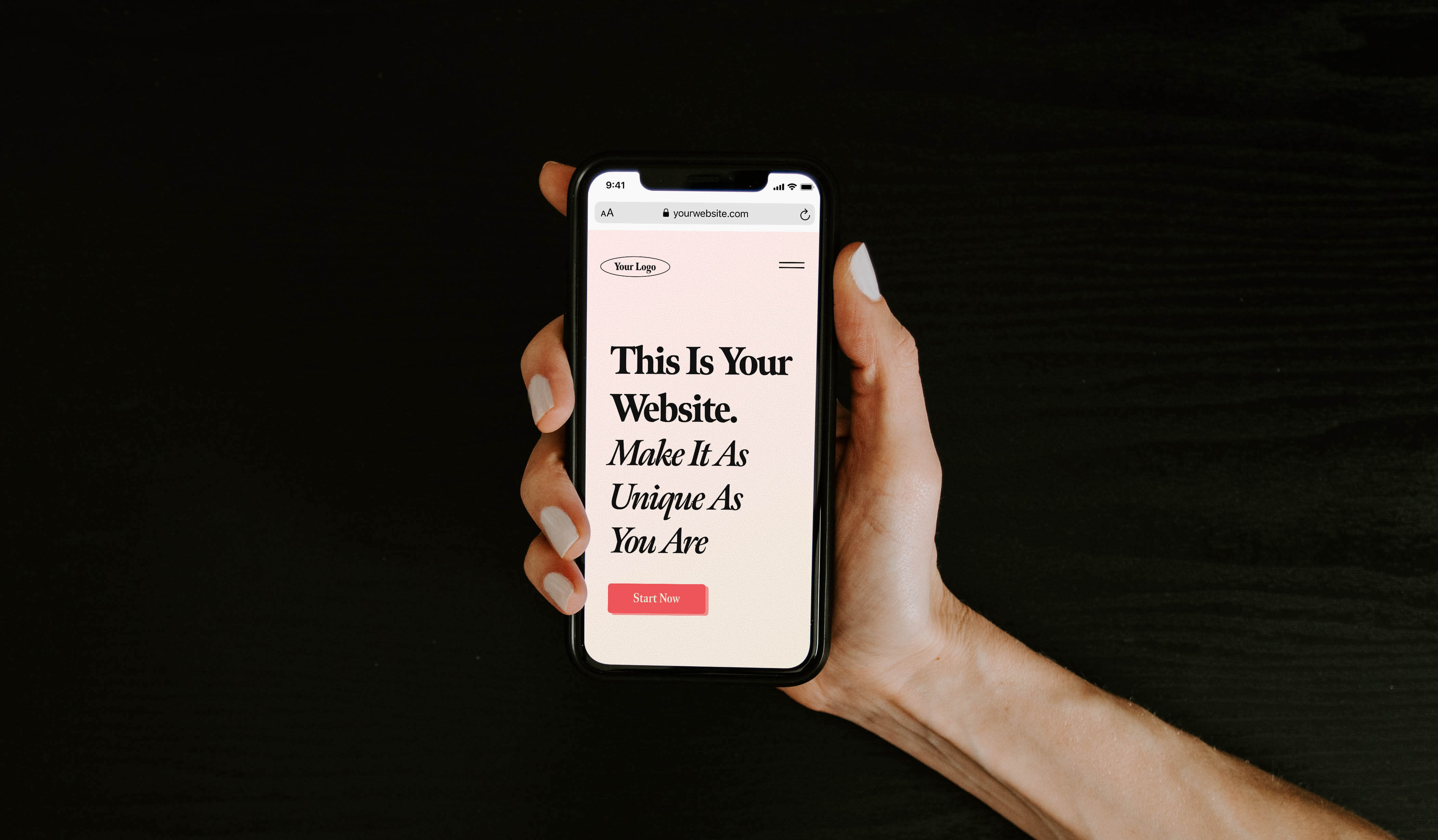 """Image of a hand holding a phone that says, """"This Is Your Website. Make It As Unique As You Are"""""""