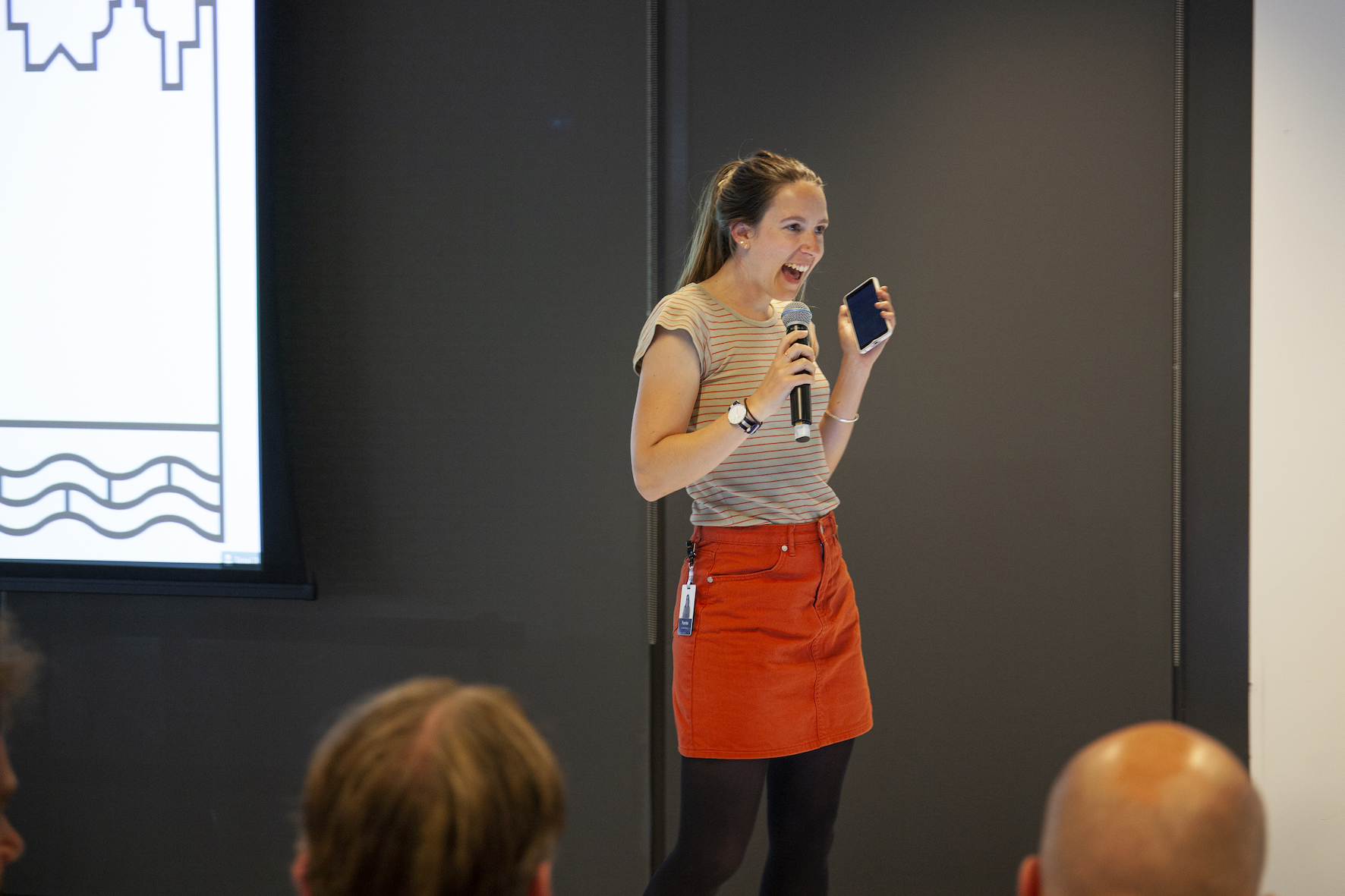 A photo of Femke presenting on stage