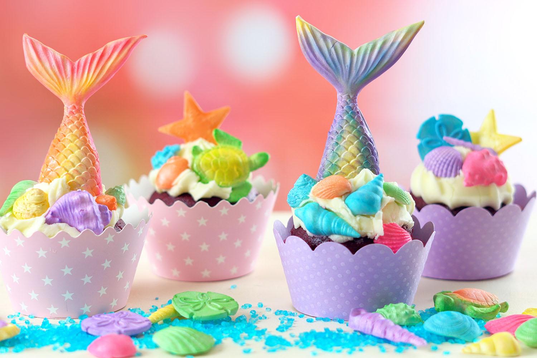 Four mermaid-themed cupcakes