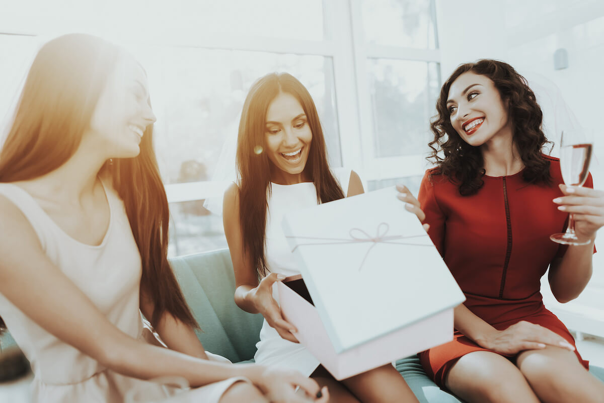 maid of honor duties: woman opening a gift