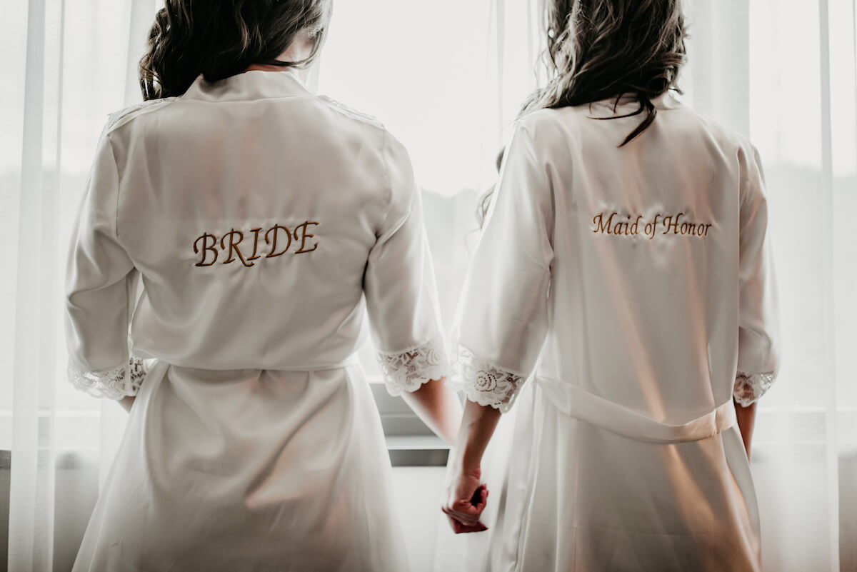 bride and maid of honor holding hands