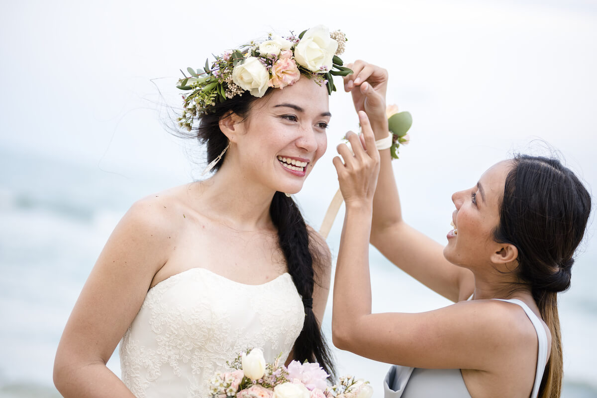 maid of honor fixing the bride's hair
