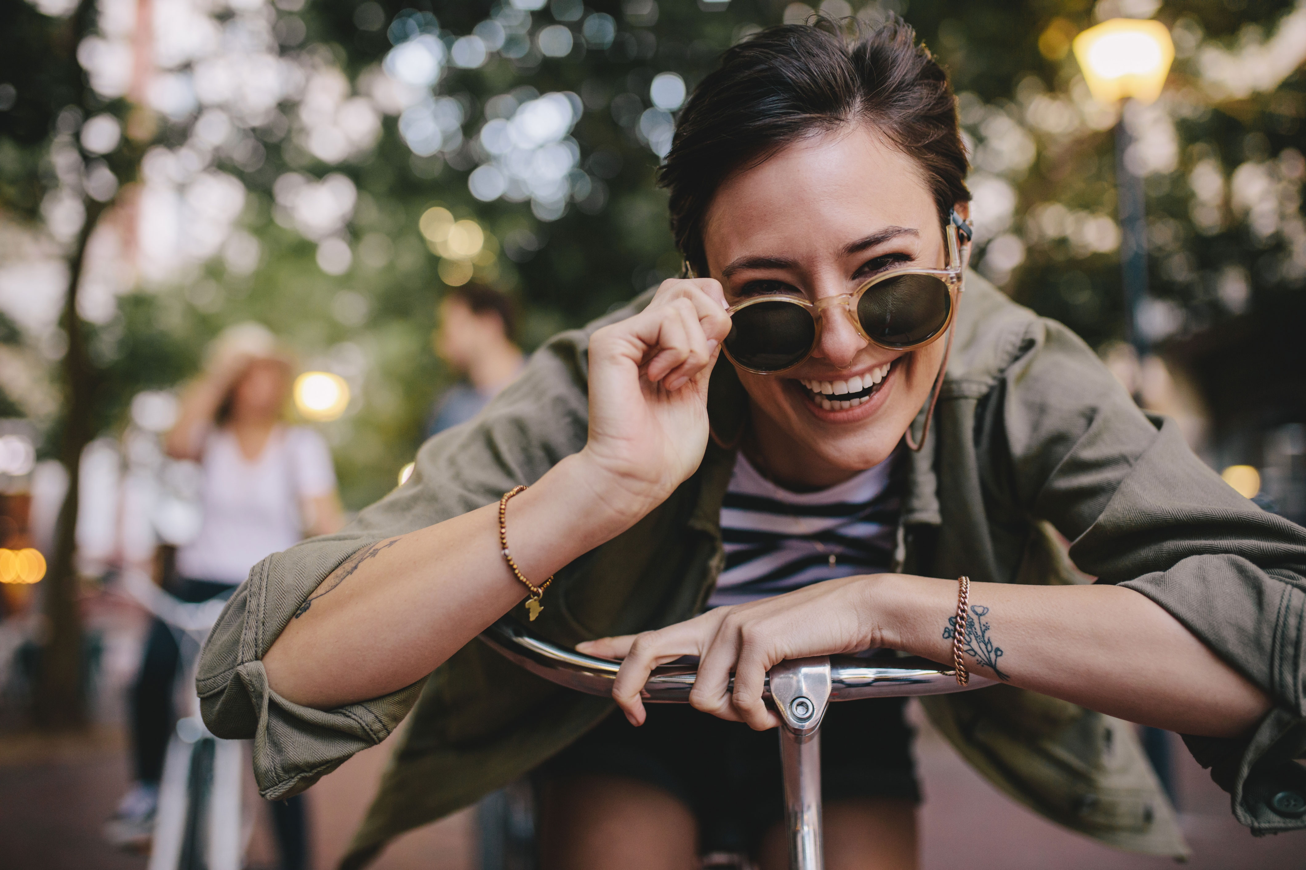 Woman on bicycle laughing.
