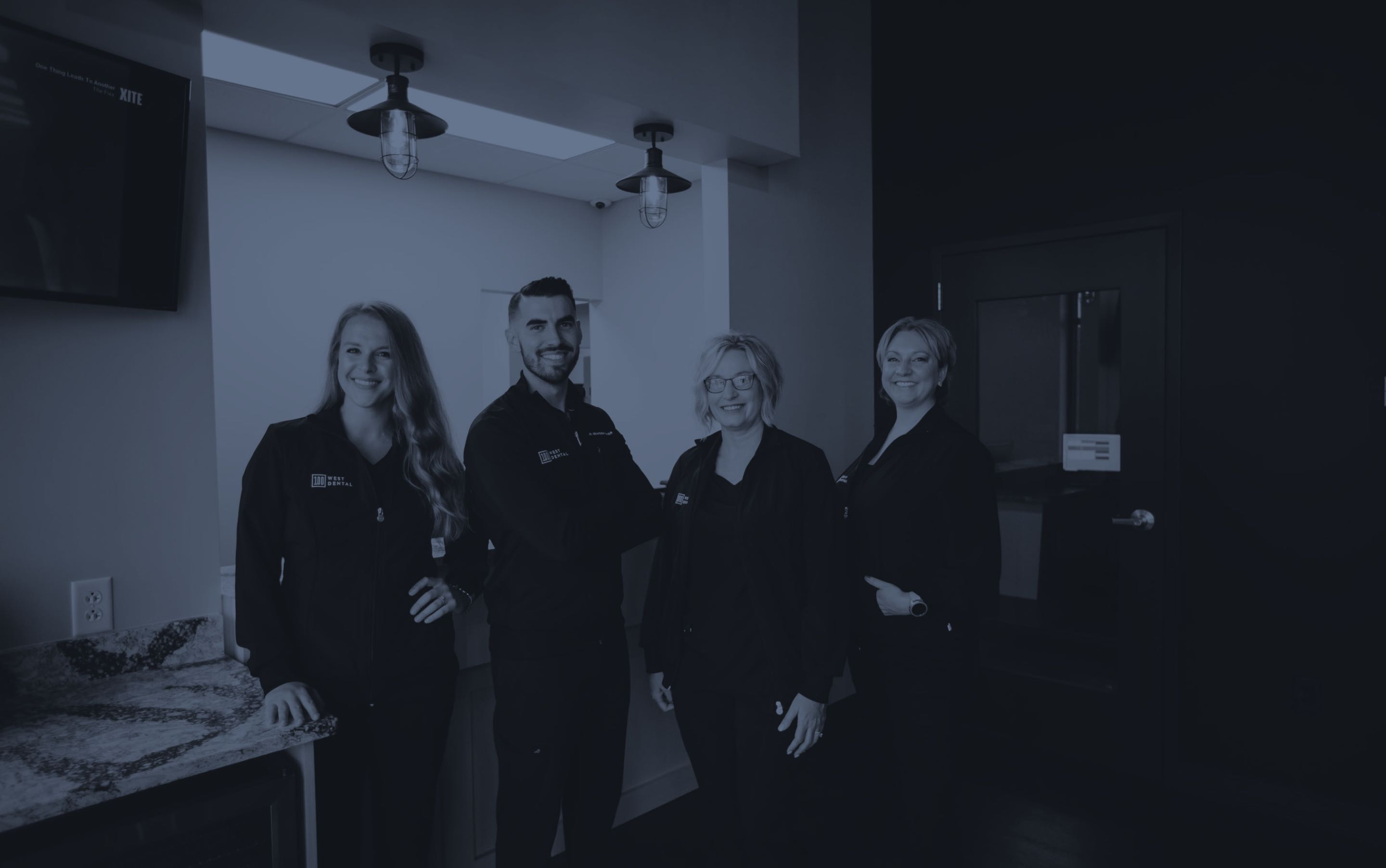Photo of the 100 West Dental team