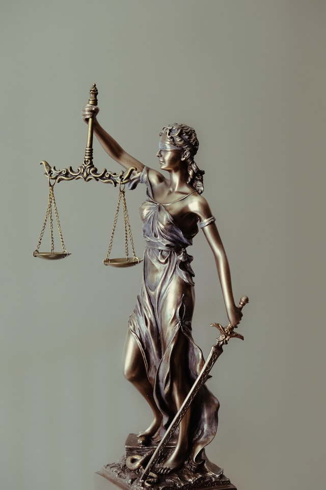 bronze statue of the scales of justice