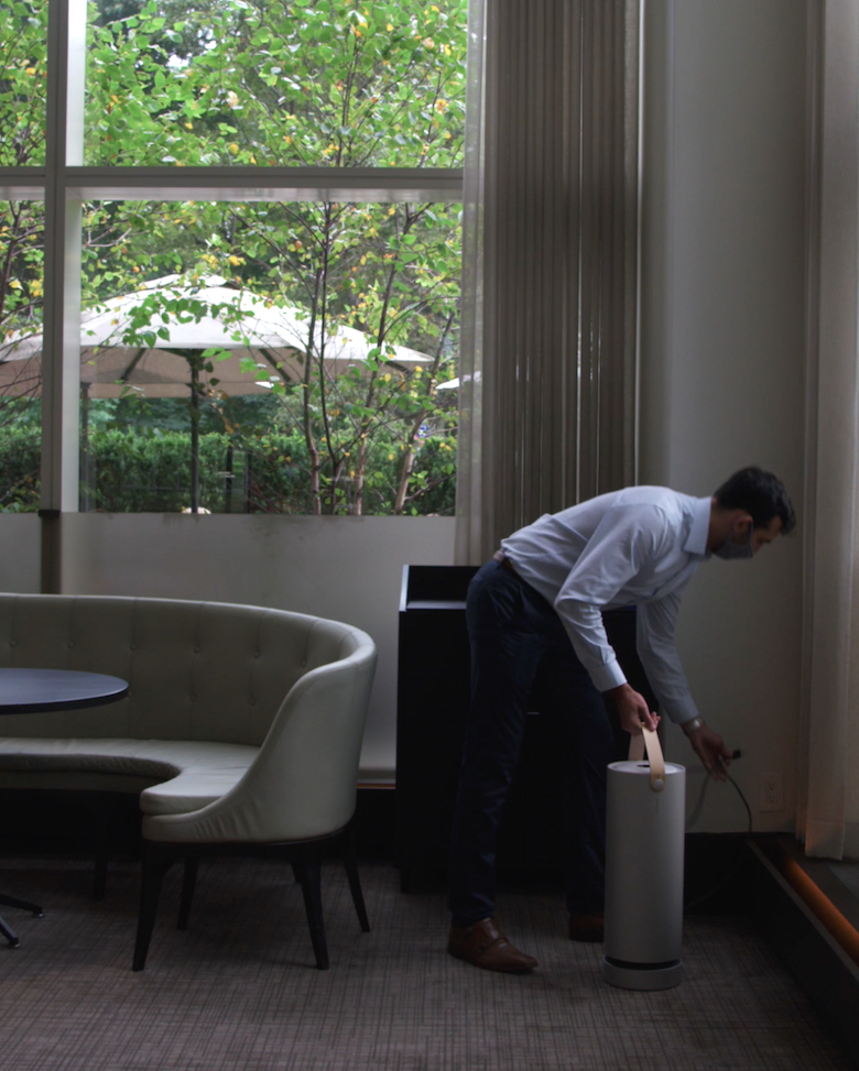 Installation of portable auxiliary air filtration unit by Lotus Biosecurity staff member.