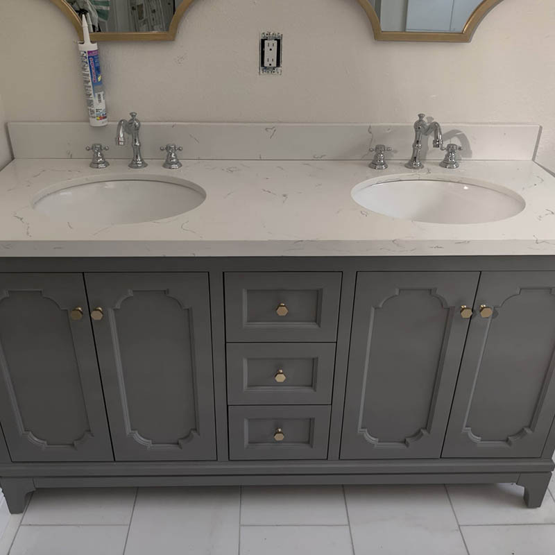 New bathroom vanity with double sinks and mirrors installed in Tampa, FL