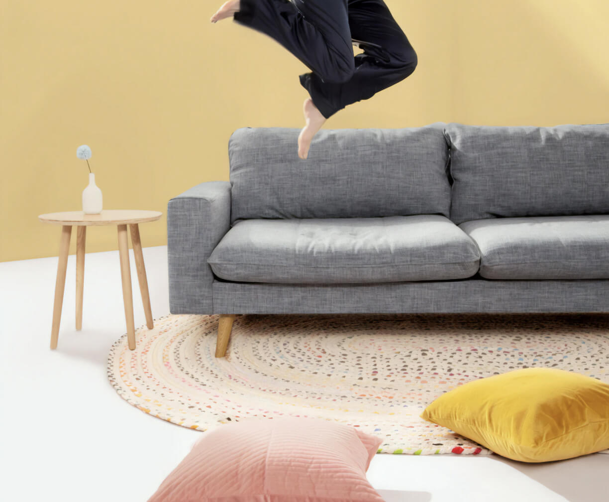 Happy resident jumping off a couch