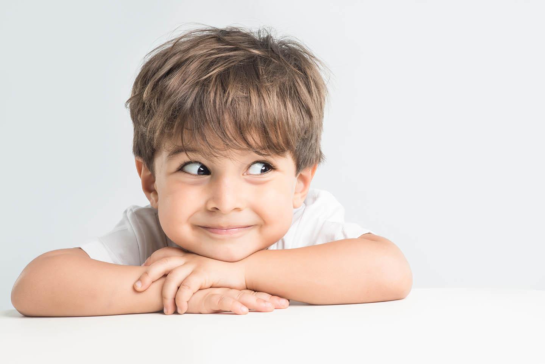 smiling side eyed boy