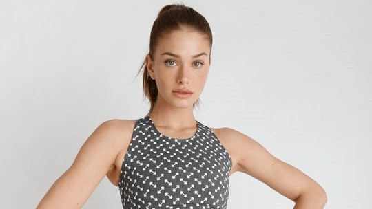 Model in barbell-printed athleisure