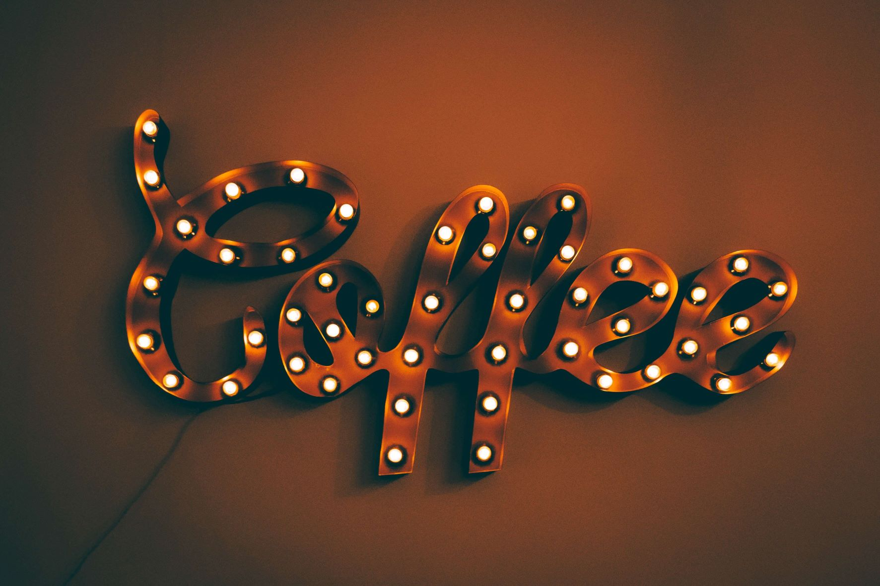 Light up sign that spells coffee