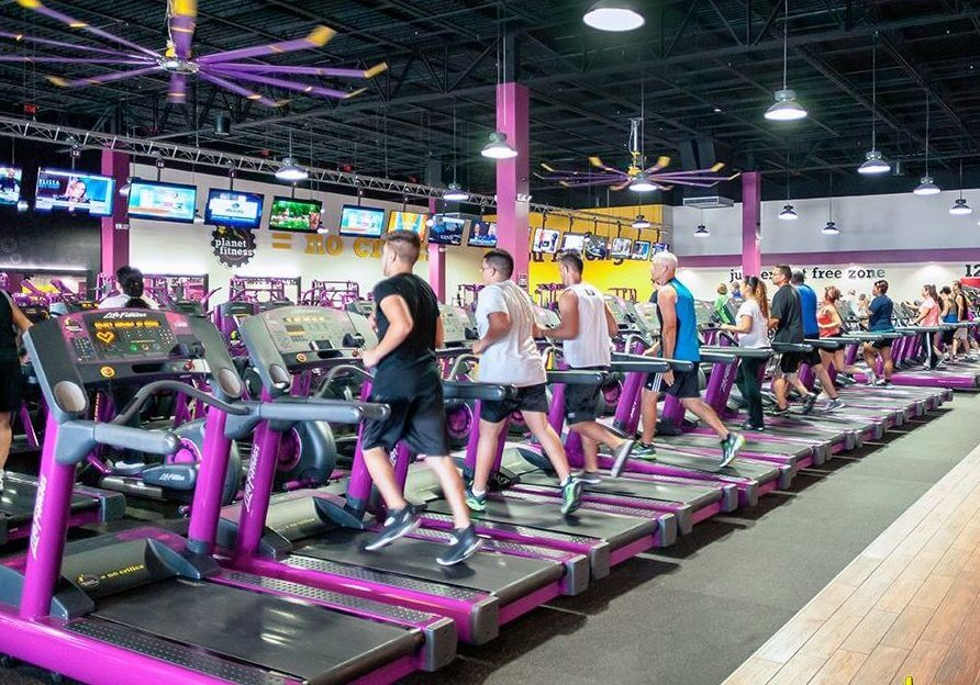 People on treadmills at Planet Fitness gym