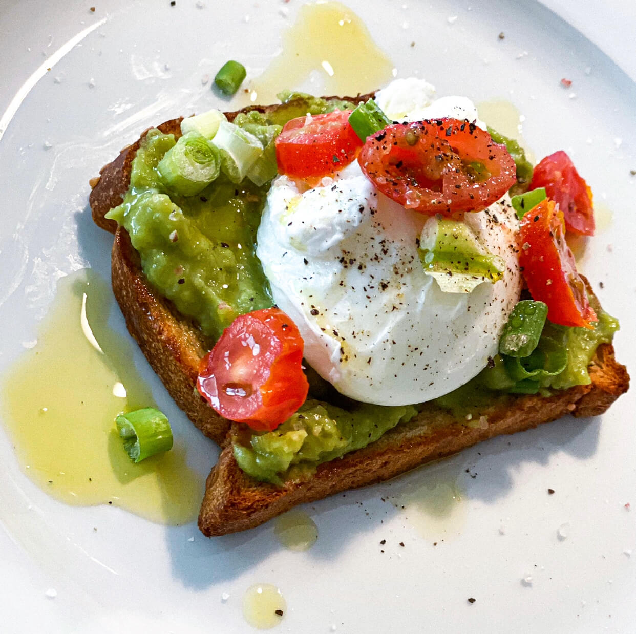 An avocado toast with poached egg
