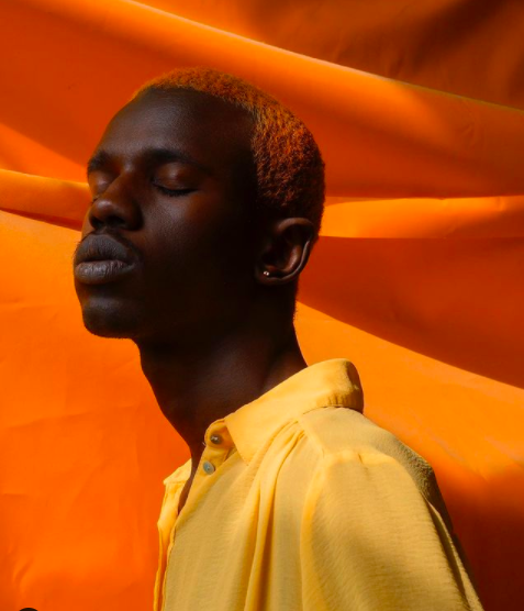 Characteristic vividness of colors in sharp contrast to his dark-skinned models capture a spectator's eye more than easily. Exactly that is what 25-year-old Yannis Davy Guibinga aims to emphasise through his lens: the revolutionary voice of the modern African continent, perspective shift on African ethnicities and their identity in post-colonial times.