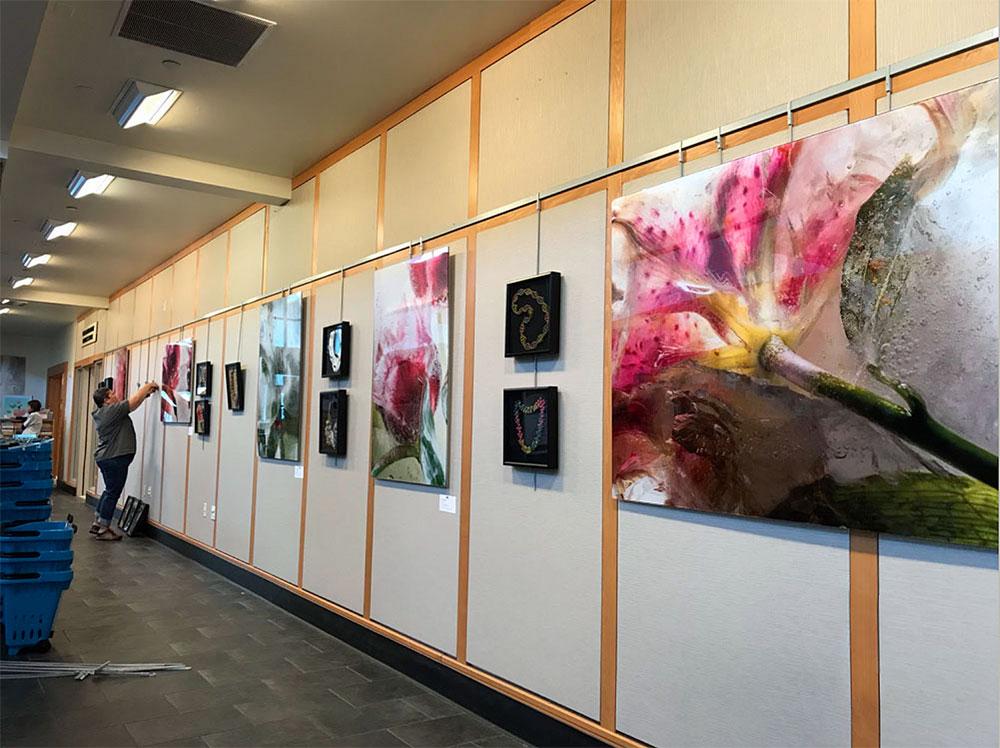 Fine art floral print in art gallery.