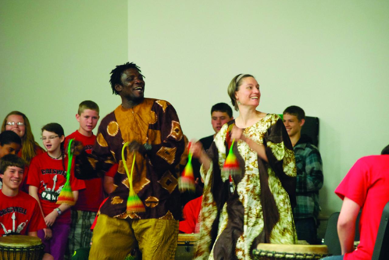 Alseny teaching an African dance class in Eugene, Oregon
