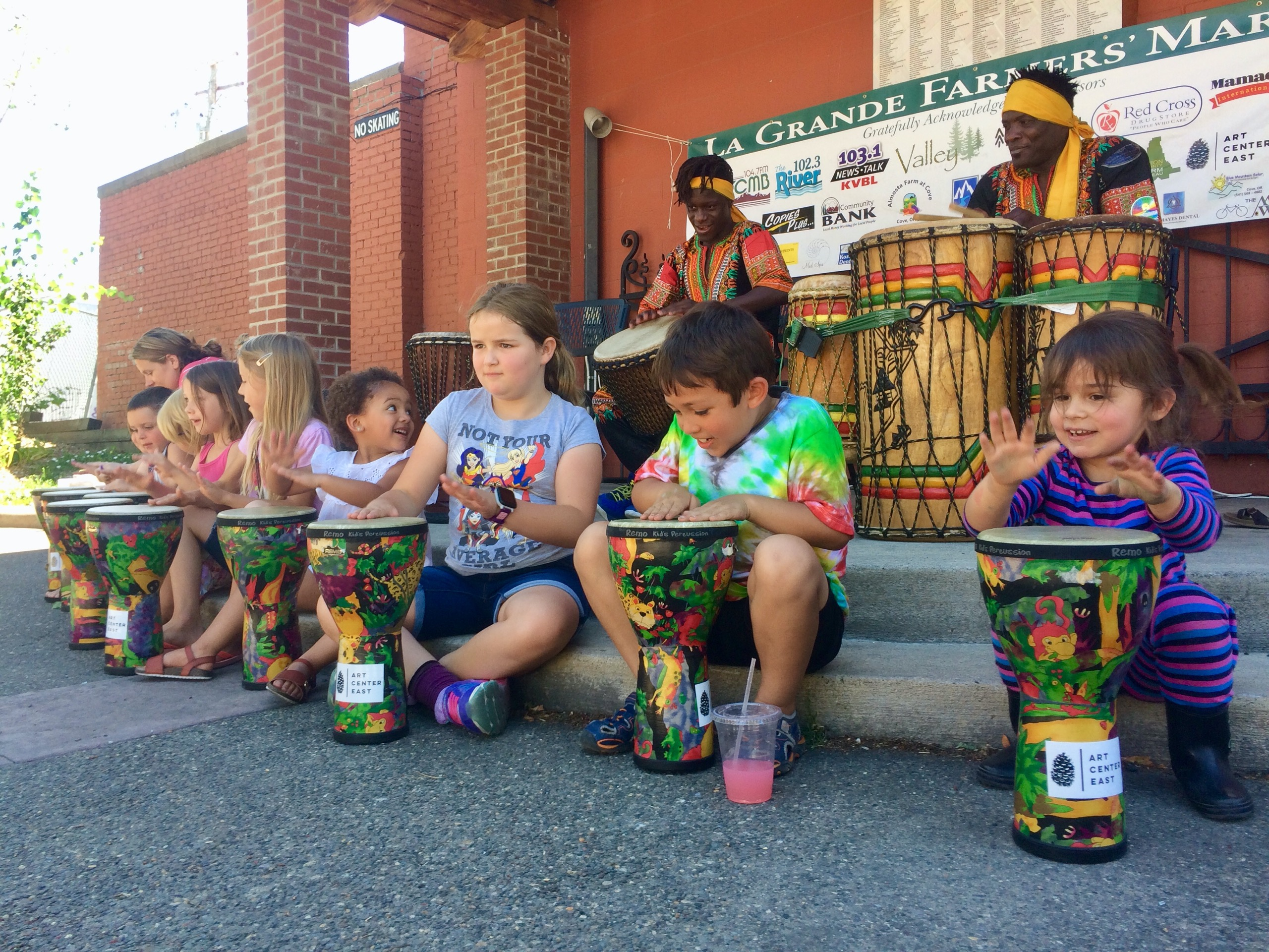 kids playing African Drums with West African Cultural Arts Institute