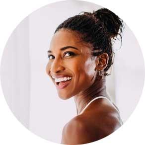 Portrait of Koya Webb in a circle, smiling