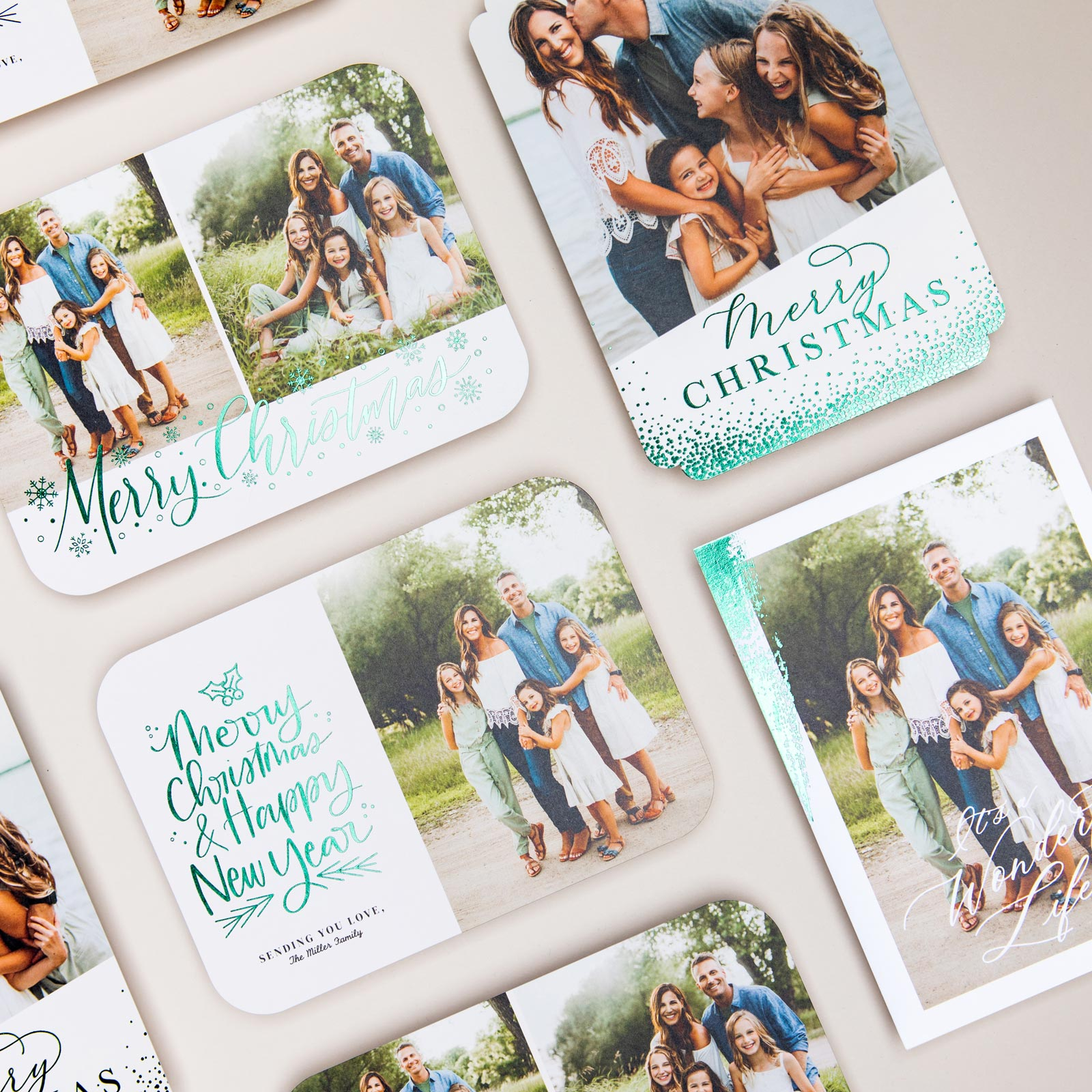 Evergreen foil-pressed holiday card designs for family photography session.