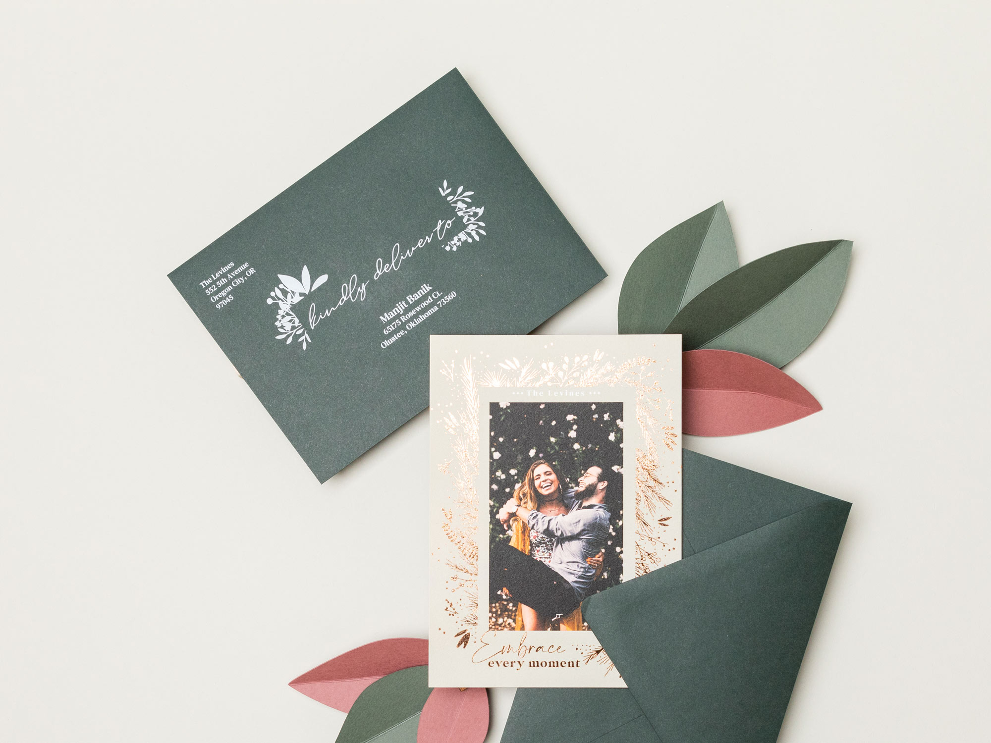 Recipient address printing in white ink on dark green holiday card envelopes by WHCC