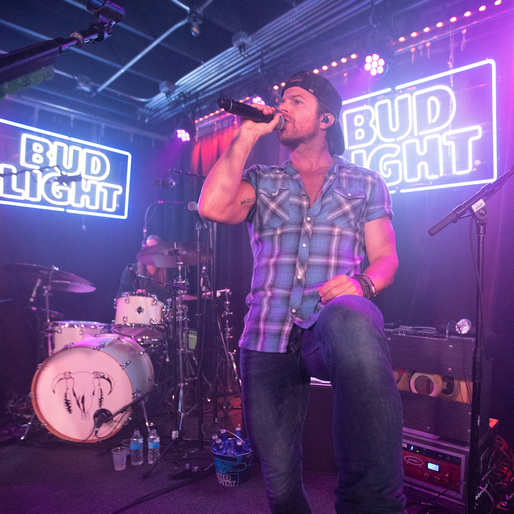 Kip Moore on stage at the Bud Light Dive Bar Tour