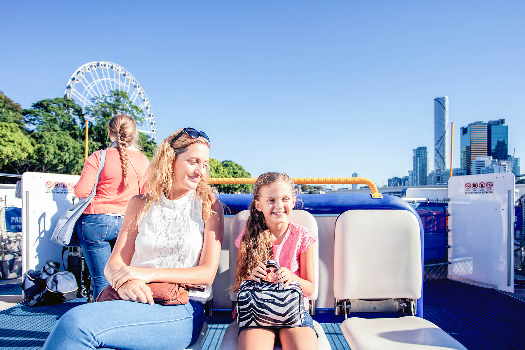Mother and daughter travelling on a CityCat in Brisbane