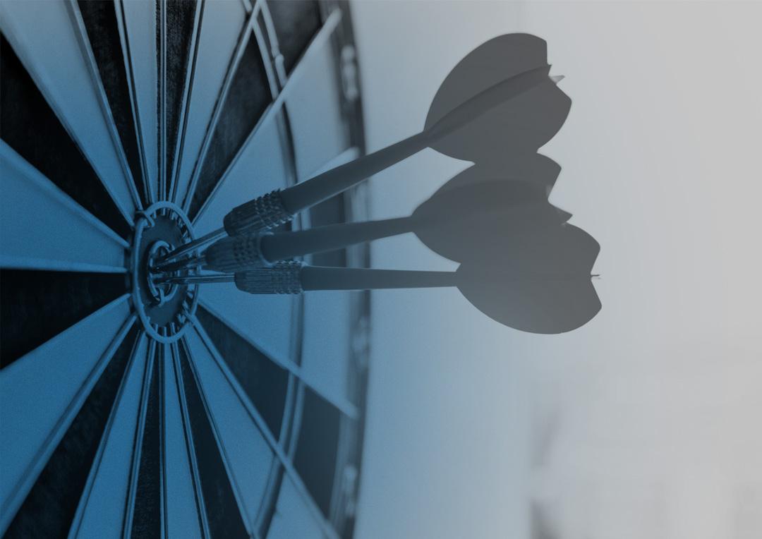 Dartboard with three darts in the bullseye