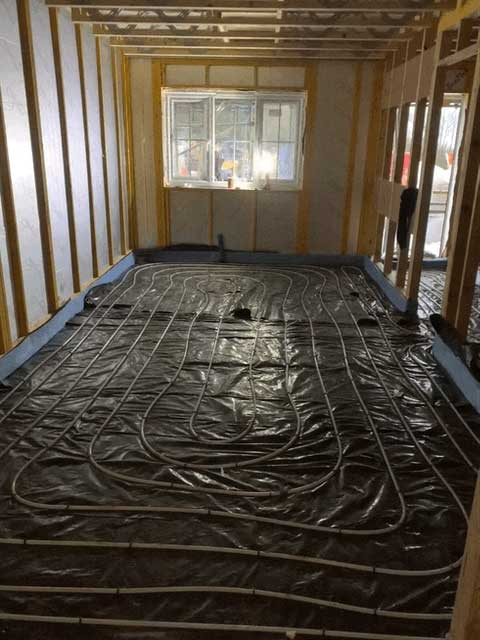 Underfloor heating being laid in a house project