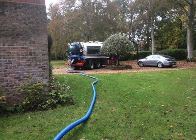 A Southern Energy Solutions van emptying a septic tank