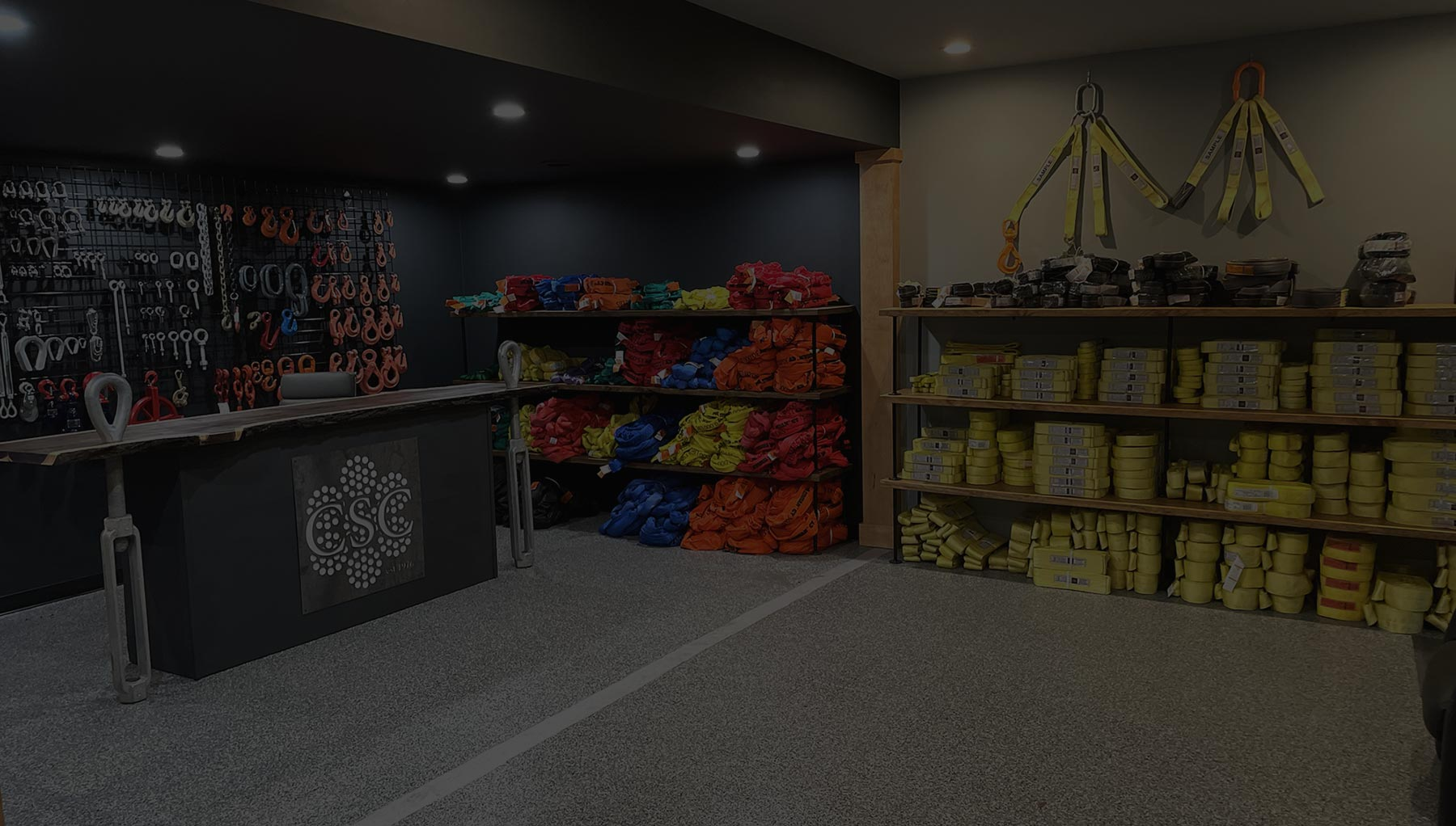 Showroom with chains, hooks, straps, links, and slings