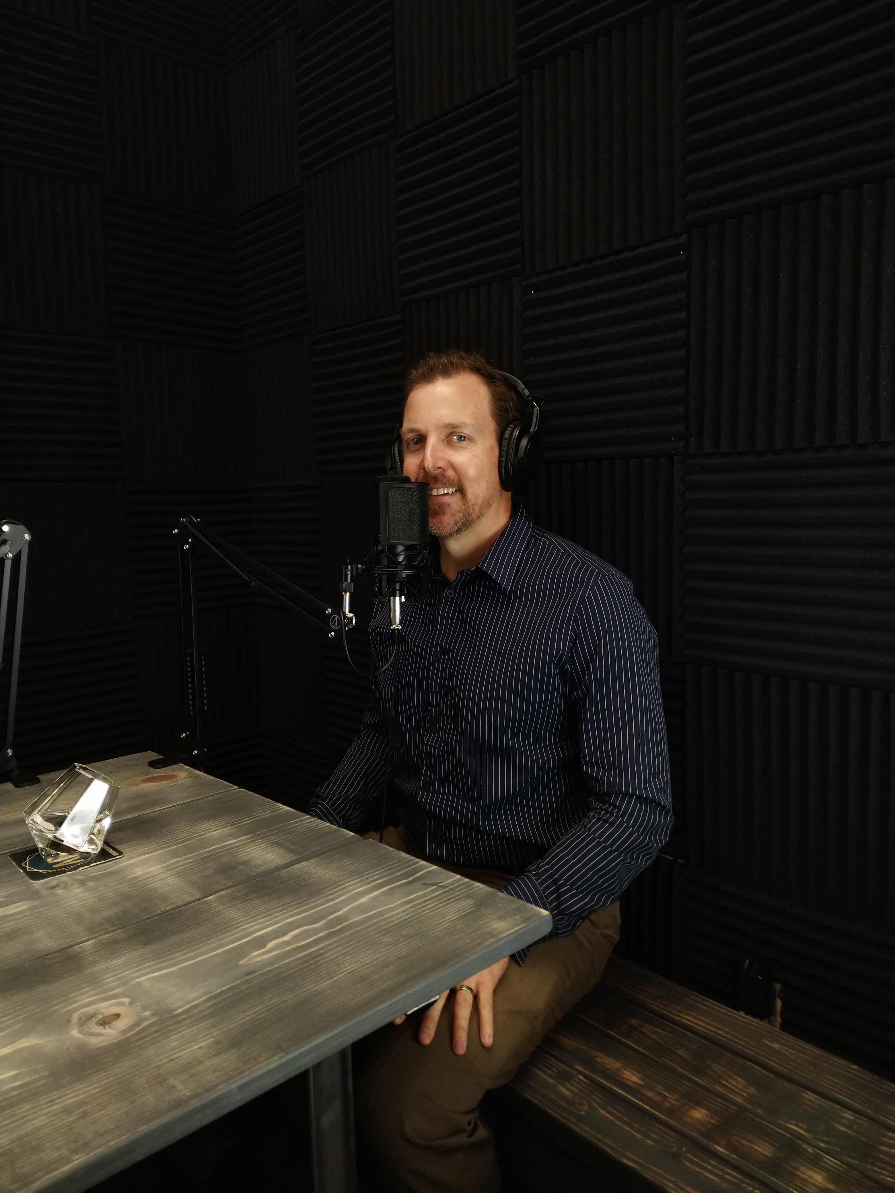 David Beseler sitting at the Gold Mine Podcast recording studio