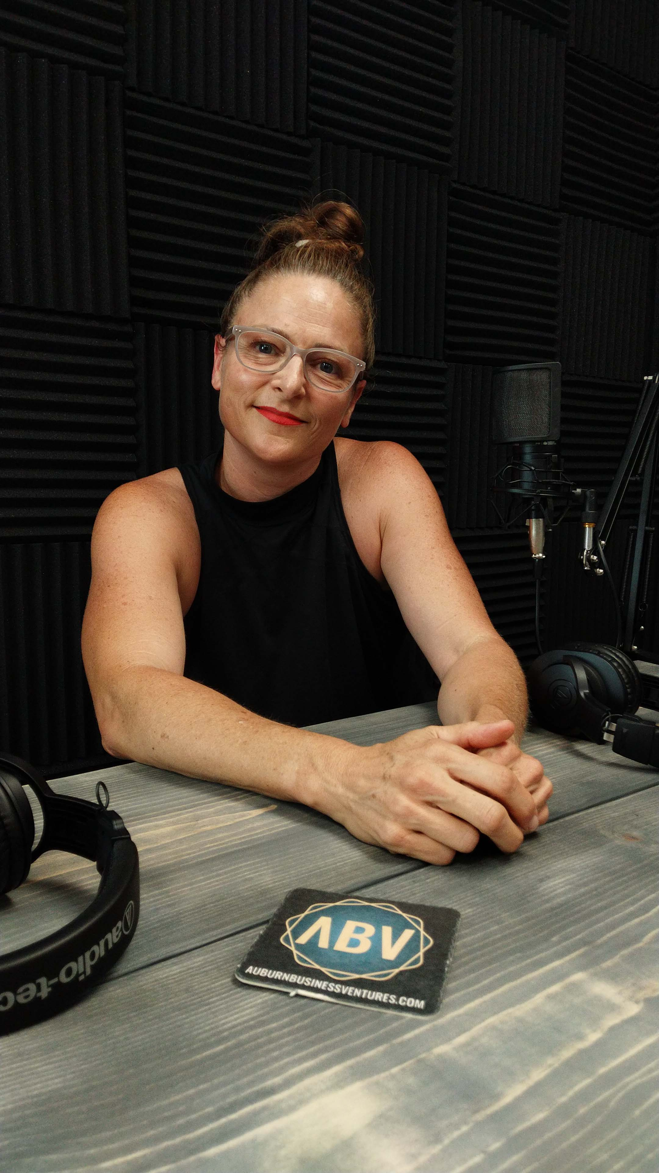 Natalie Otis sitting at the Gold Mine Podcast recording studio