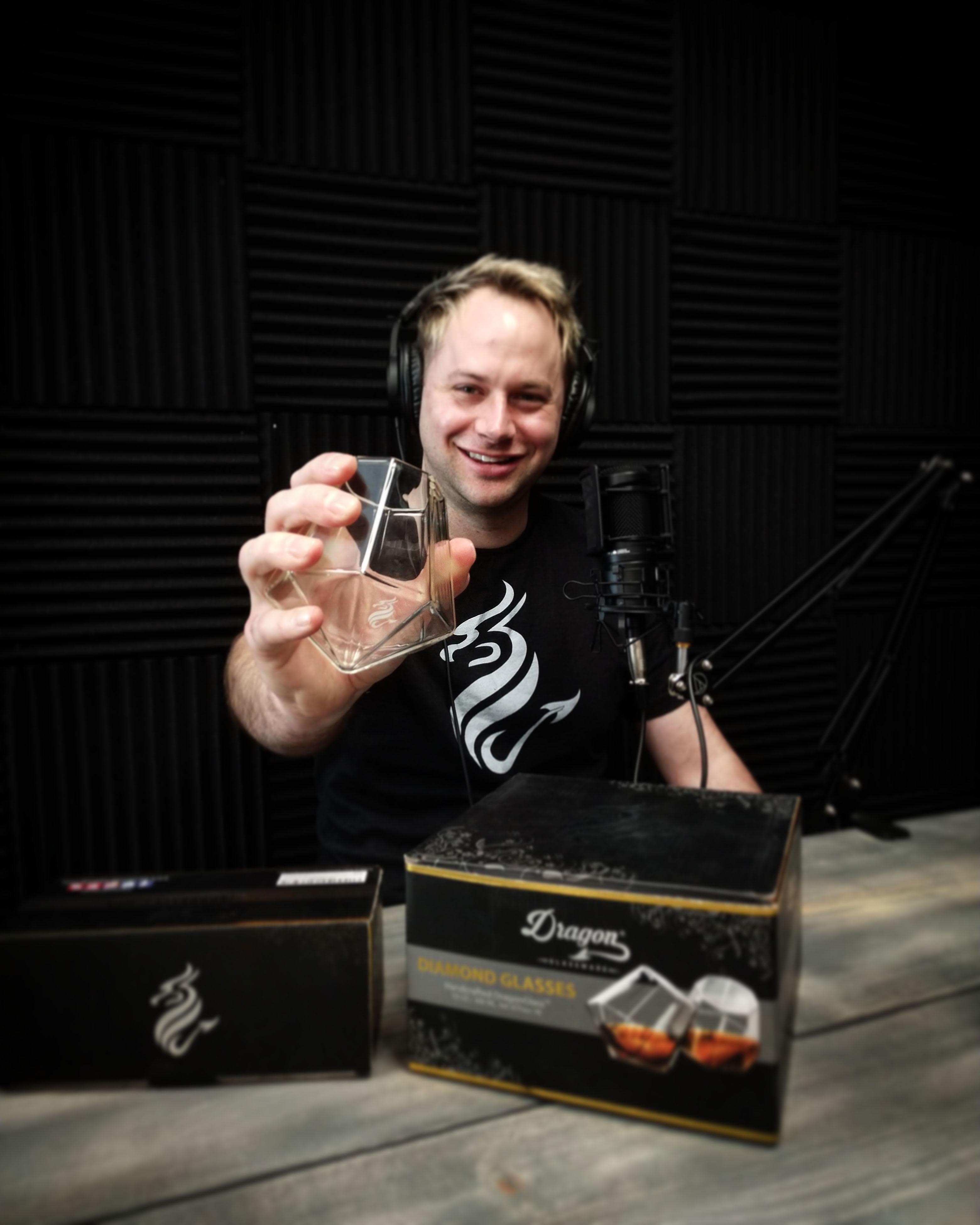 Matt Rollens sitting at the Gold Mine Podcast recording studio