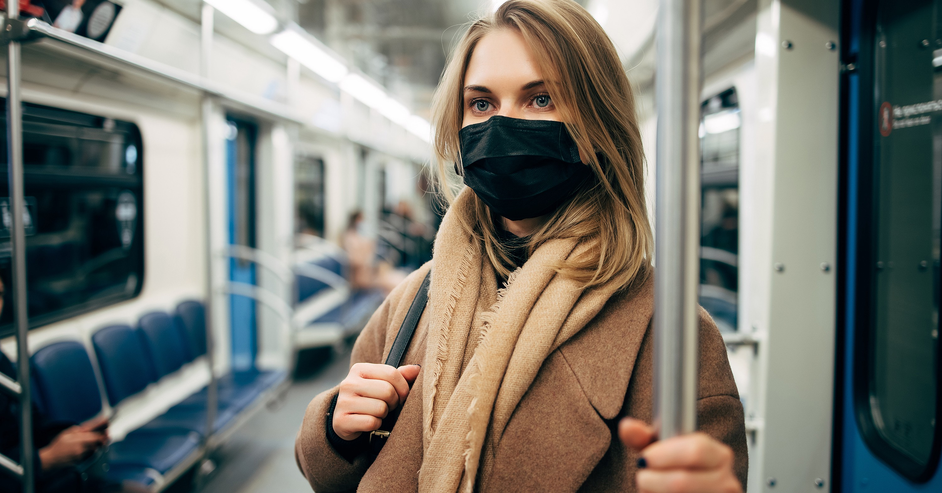 Covid-19 has fundamentally changed everything about how we work, including our commute. Image of a woman wearing a face mask.