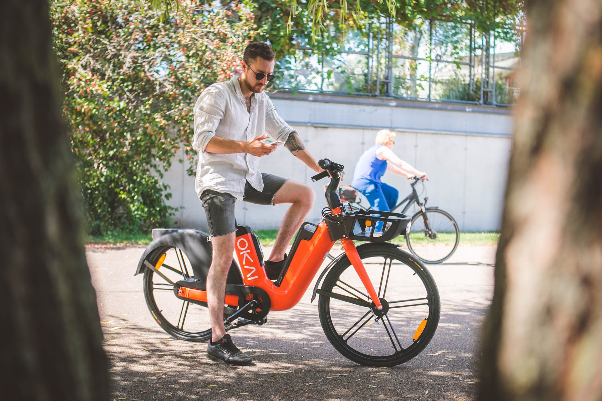 Man looking at online e-bike insurance on his phone.