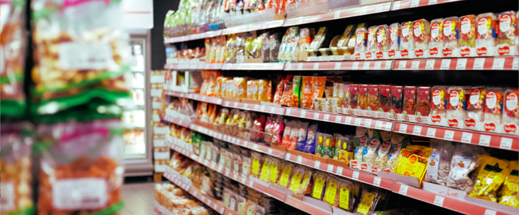 Products lining the shelves of a grocery store aisle.