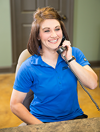 Cheerful receptionist on the phone