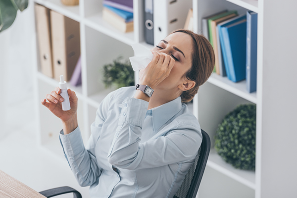 woman suffering from Chronic runny nose