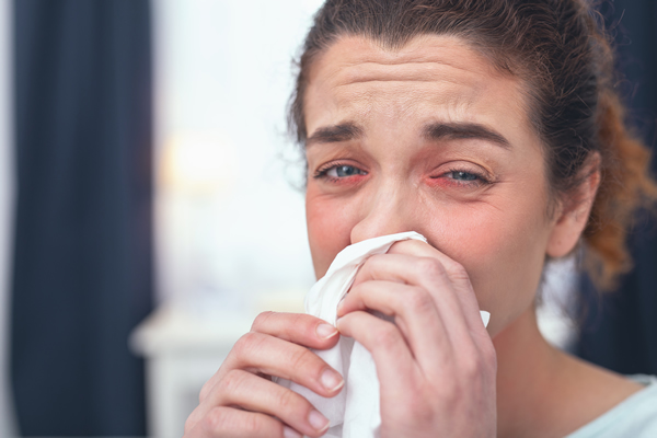 Woman suffering with nasal discharge
