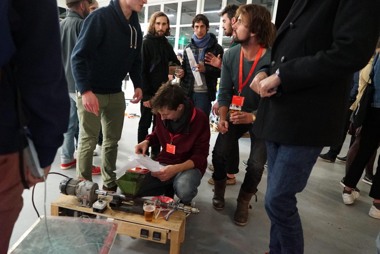 men explaining an extrusion machine