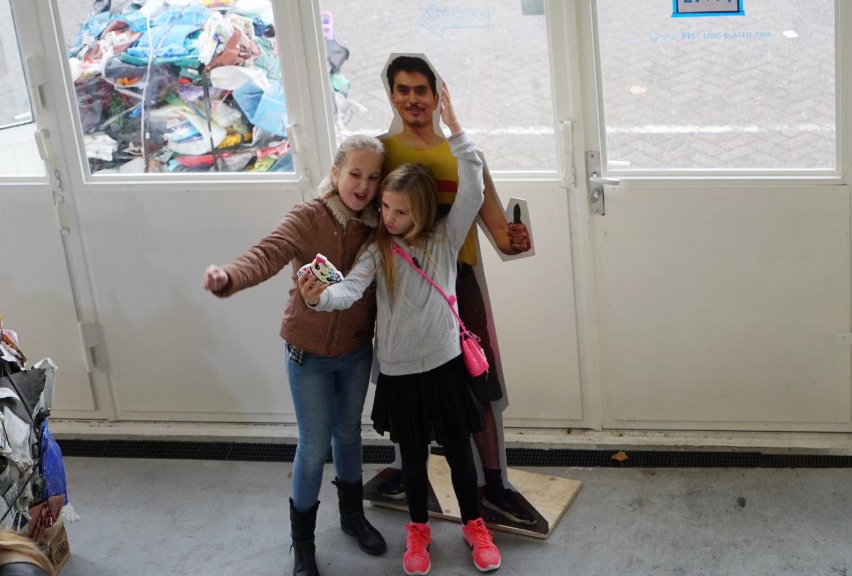 girls at the precious plastic exhibition