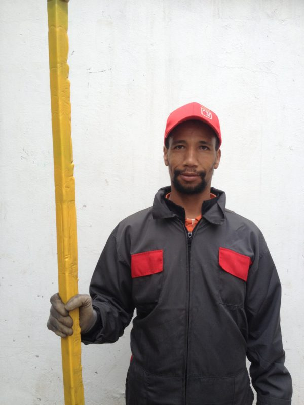 worker holding a beam