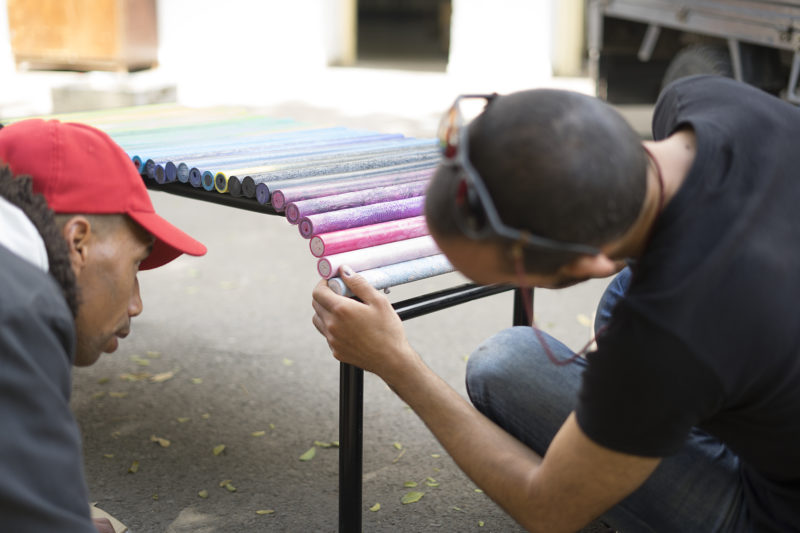 men working on a plastic bench