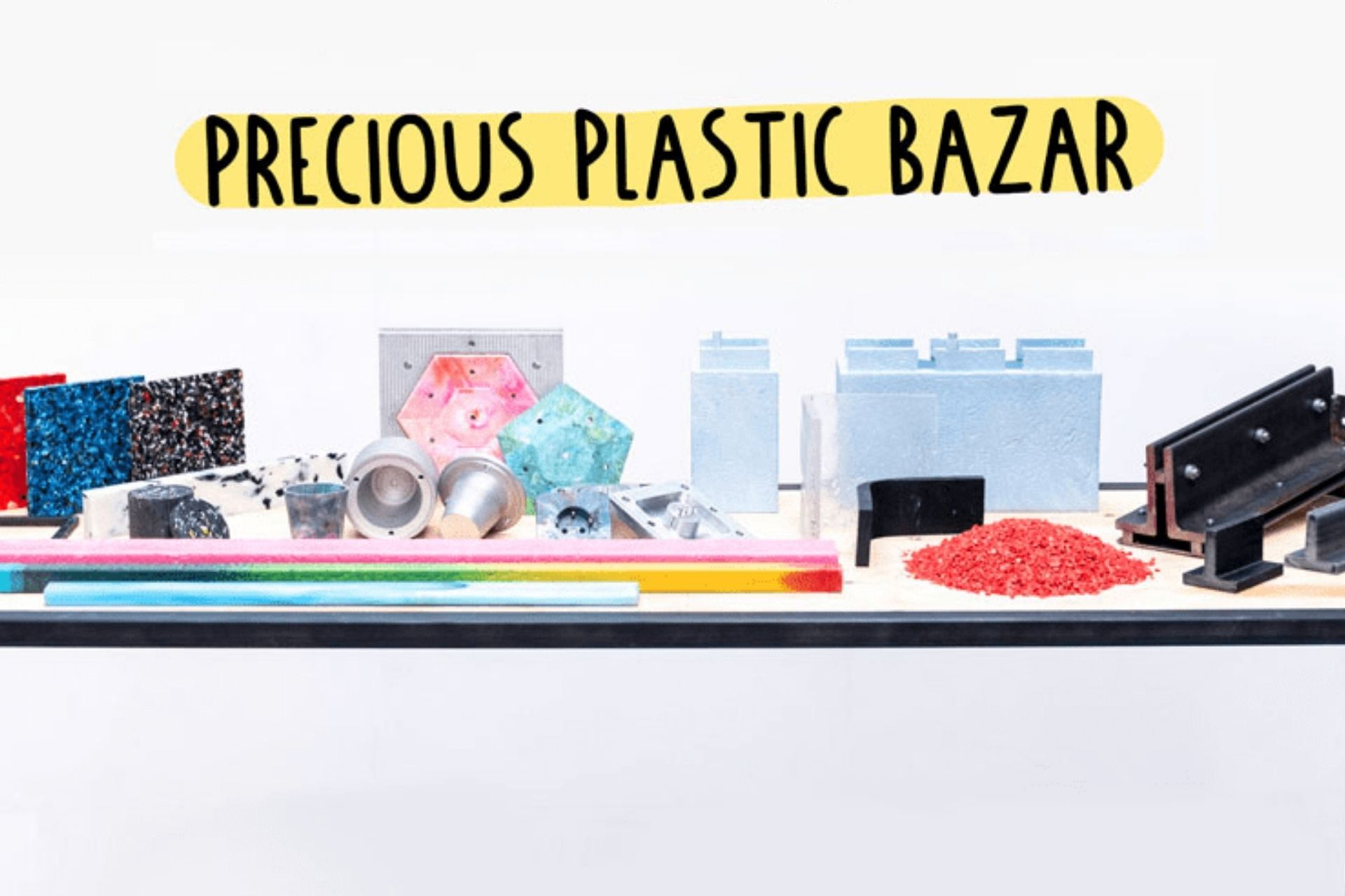 table with recycled plastic objects sold on the Precious Plastic bazar