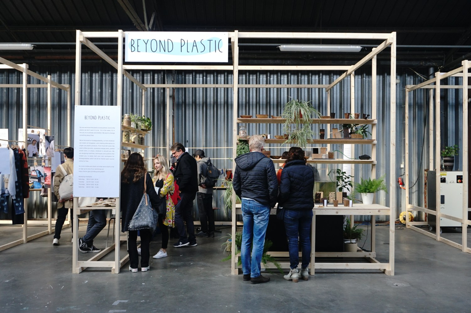 exhibition stand made of wood sticks and plants