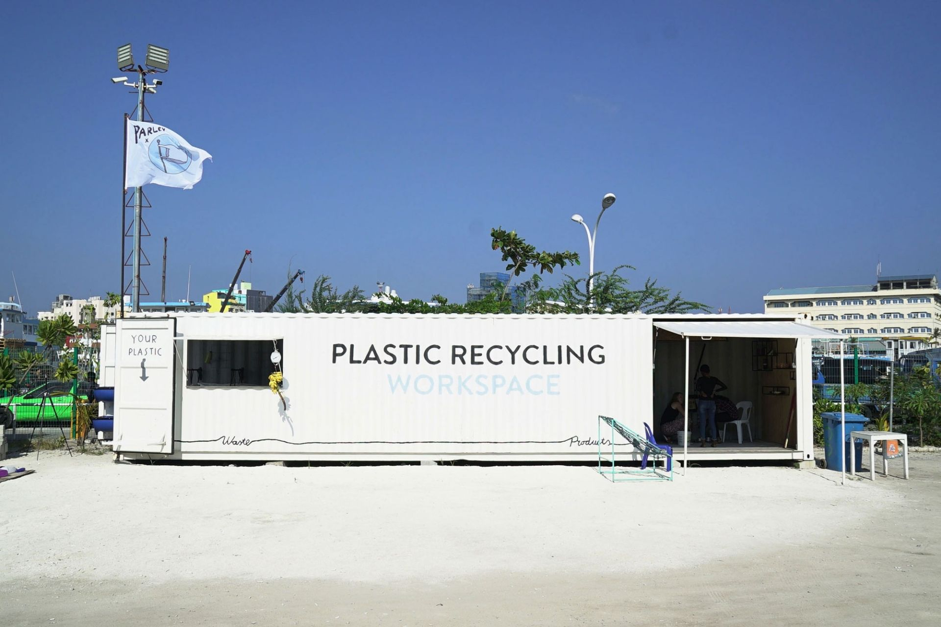 Precious Plastic recycling workspace container in Maldives