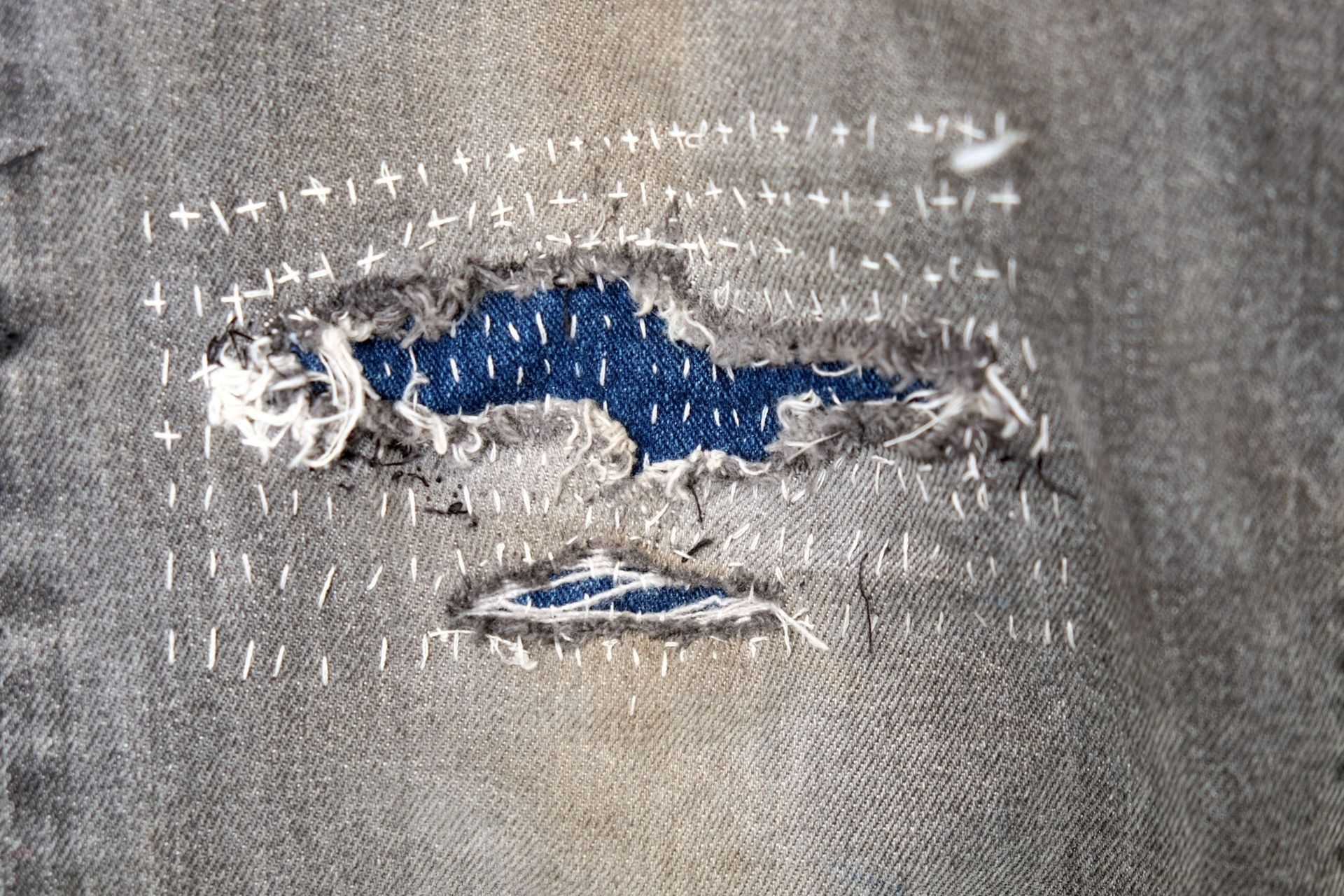 Repaired fabric with sewing technique.
